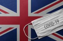Britische Flagge und Covid-19 Mundschutz
