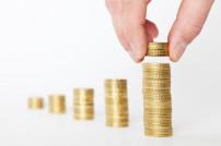 Preisanpassung: Münzen und Hand